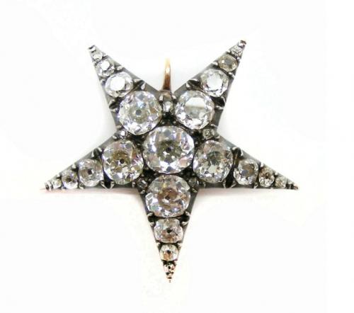 Antique diamond set star brooch